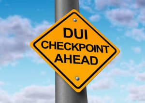 Sobriety and drunk driving checkpoint representing the dangers of drivers that are intoxicated above the legal limit by alcohol or other drugs while they are behind the wheel of a vehicule.